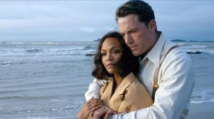 This image released by Warner Bros Entertainment shows Zoe Saldana left and Ben Affleck in a scene from Live By Night Claire Folger Warner Bros Entertainment via AP